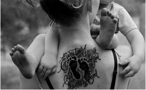 Upper Back Footprint Tattoo