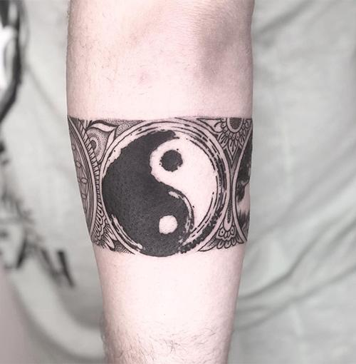 Yin-Yang Forearm Tattoo