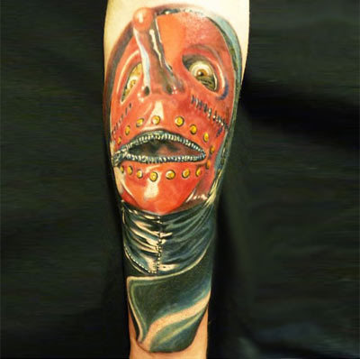 Zipped mask tattoo