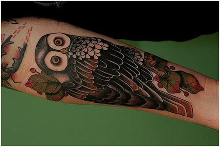 forearm owl tattoo