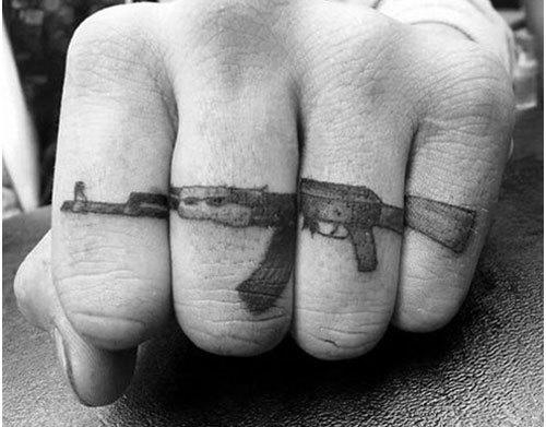gun finger tattoo