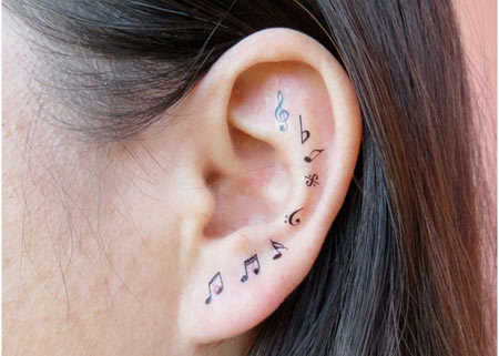 music notes ear tattoo