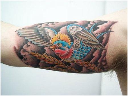 single bird in blue color tattoo