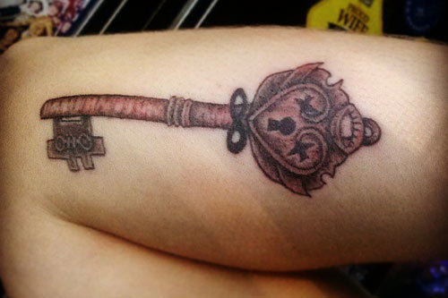 wooden key tattoo