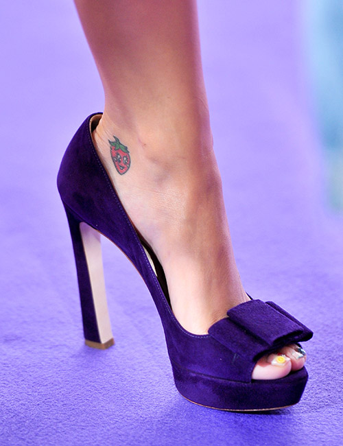 A Strawberry Tattoo On Her Ankle