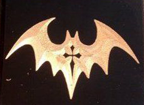 Bat motif with crucifix tattoo