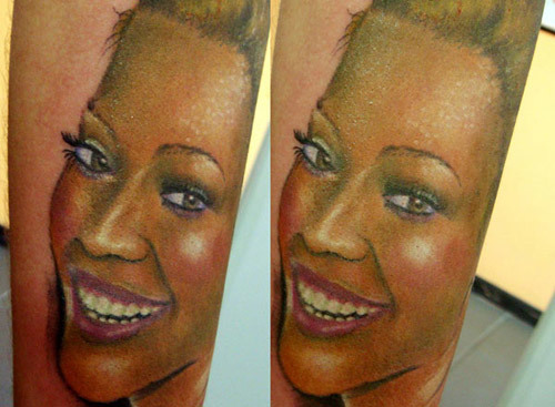 beyonce's half face laughing tattoo