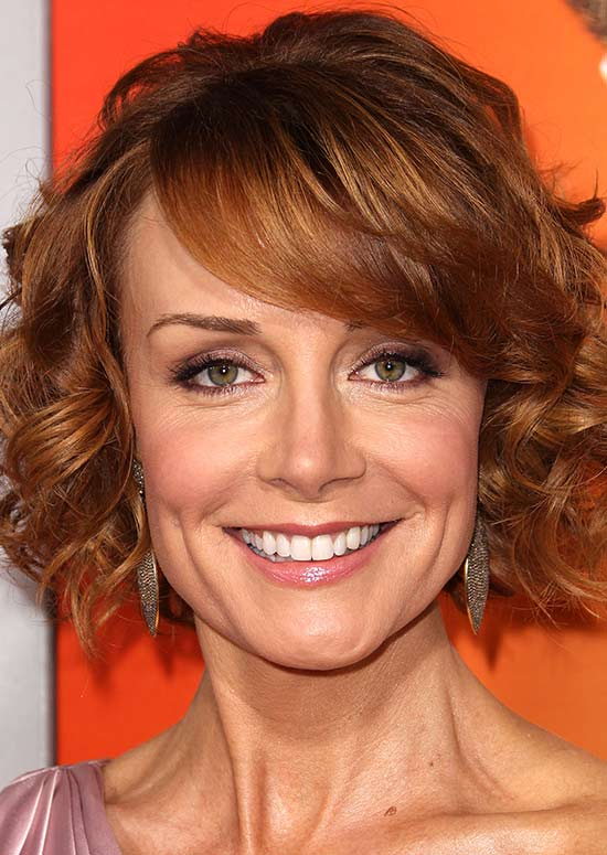 Curly Reddish Blonde Bob with Puff and Side-Swept Bangs