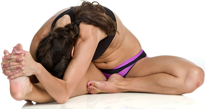 Head To Knee Stretching Pose - Bikram Yoga