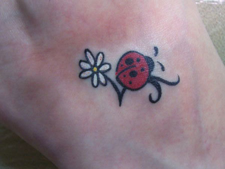 Ladybug with White flower Tattoo