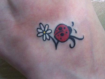 Ladybug with White flower Tattoo
