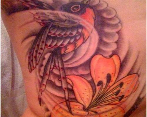 Lily with hummingbird tattoo