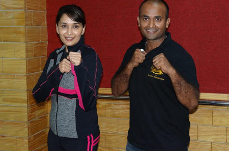 Madhuri with her personal trainer