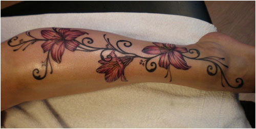 Pink lily with stripes tattoo