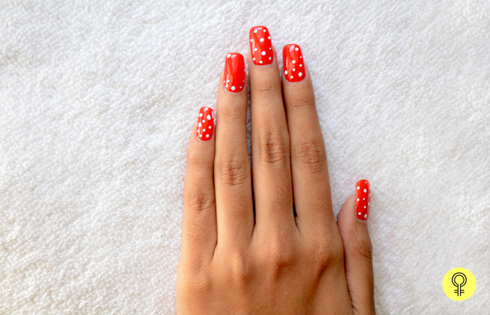 2. Put white dots with the toothpick - Red and White Christmas Snowflake Nail Art