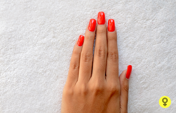 1. Apply Red Nail Polish - Red and White Christmas Snowflake Nail Art