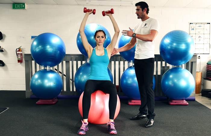 Swiss Ball Exercises - Swiss Ball Dumbbell Shoulder Press