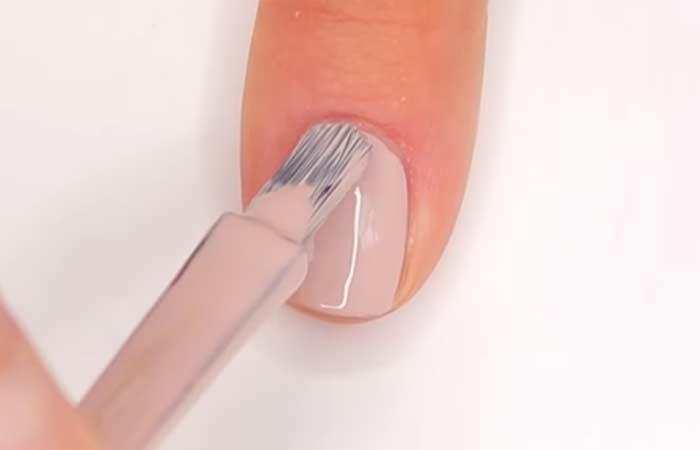 Apply The Nude Or Flesh-Toned Nail Polish