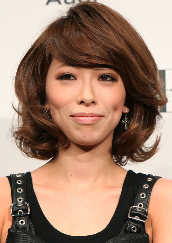 Volumized-Curly-Bob-with-Side-Swept-Bangs