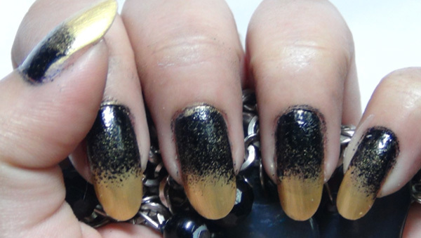 black and golden ombre nails four