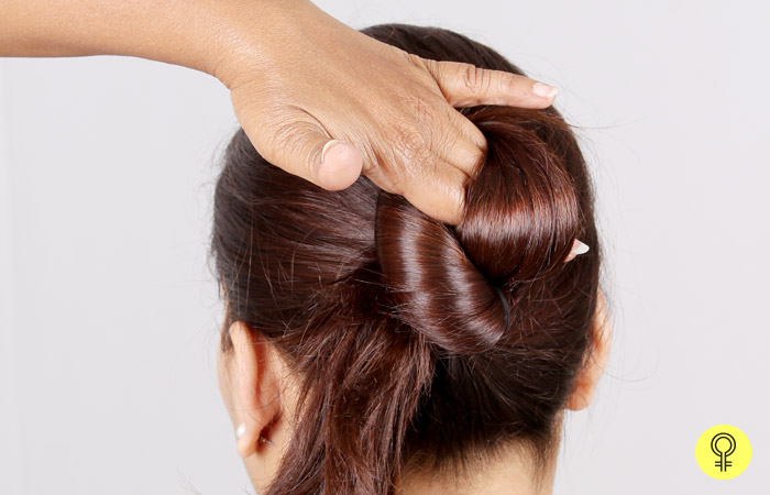 Starting at the base of the ponytail