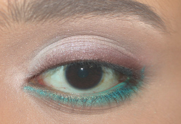 Step 4: Apply Shimmery Turquoise Kohl to the Lower Lash Line