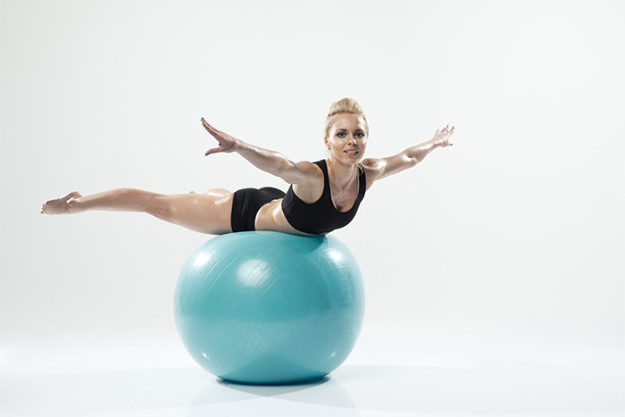 Spinal Balance Exercise Using Swiss Ball Excercise