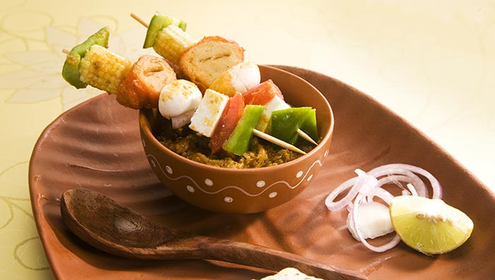 Baby Corn, Capsicum, Paneer And Tomato On A Skewer