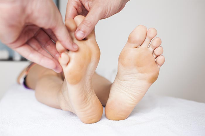 Massaging The Fingertips And Toe-Tips