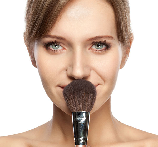 beautiful-woman-holding-makeup-brush