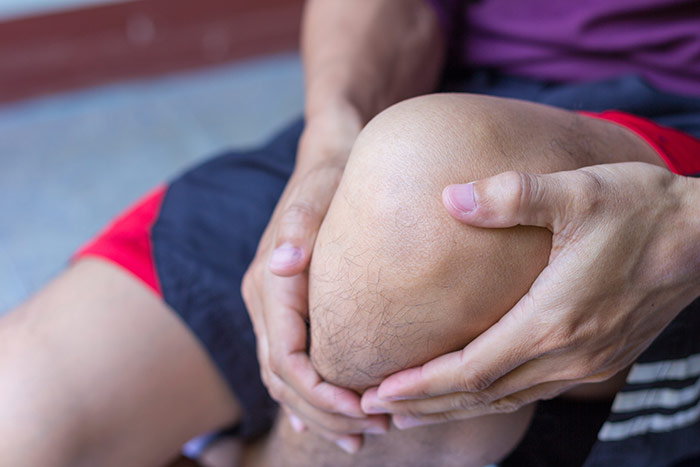 man-with-knee-pain-and-feeling-bad