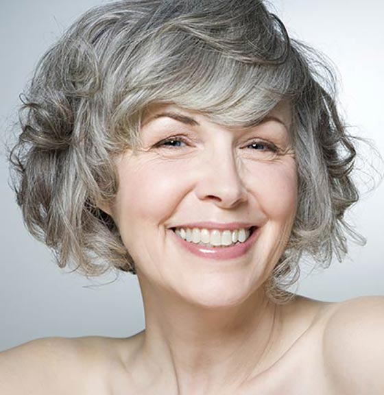 Gray-Curly-Bob-With-Side-Swept-Bangs