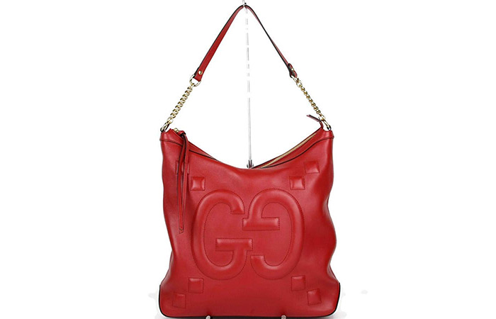 12. Gucci Leather Embossed Hobo Chain Bag