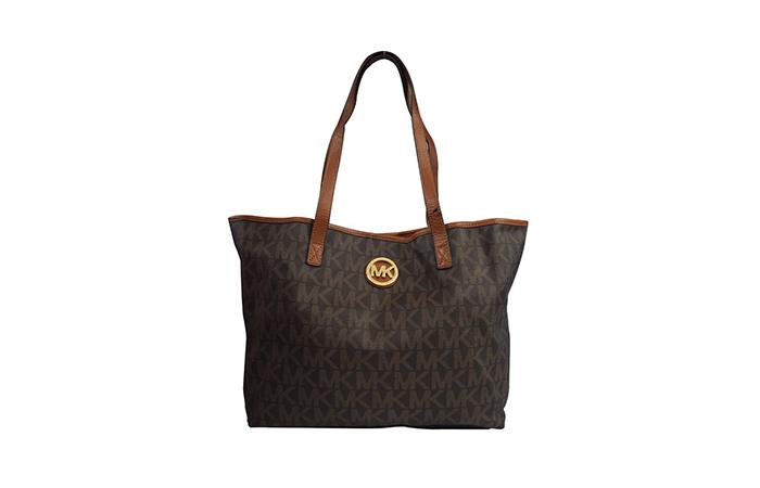 Most Popular Ladies Handbags In India - 1. Michael Kors Medium Travel Tote