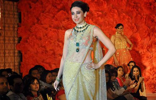 Nude Sheer Net Saree With Orange Embellished Blouse