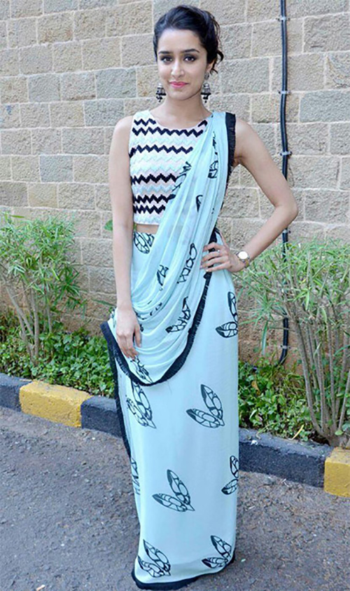 Teal Blue Georgette Saree With Zig Zag Patterned Blouse