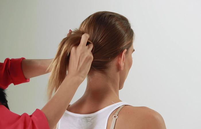 Topsy-tail-your-ponytail-to-add-a-bit-of-quirk-to-your-hairdo