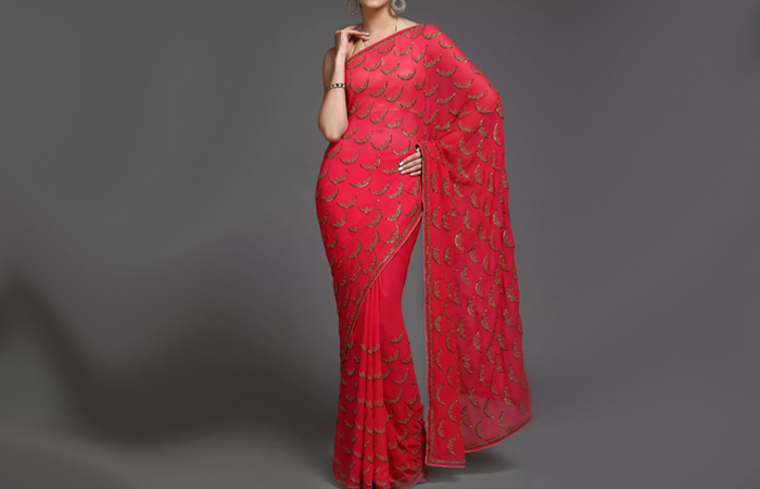 Best Georgette Sarees For Women In India - 15. Hot Pink Saree In Fish Scale Motif
