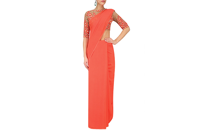 Best Georgette Sarees For Women In India - 2. Plain Coral Saree With Sequinned Blouse