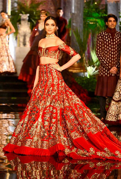 1. Deepika Padukone Wearing Red Off Shoulder Lehenga Choli