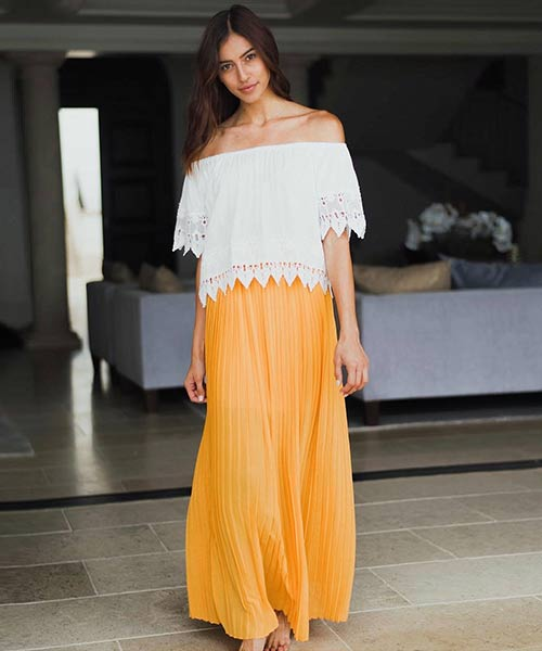 16. Pleated Maxi Skirt With A White Lace Top