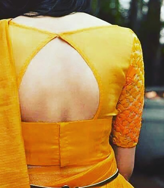 37. Pot Neck And Back Open Blouse Design For Yellow Silk Saree