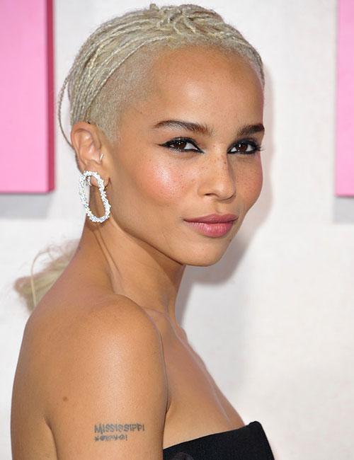 16. Blonde Micro Braids Loose Bun