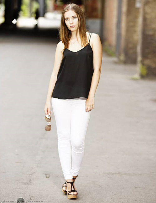 4. White Jeans With Black Top And Accessories