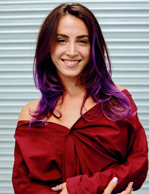 2. Electric Purple Highlights On Chocolate Brown Hair