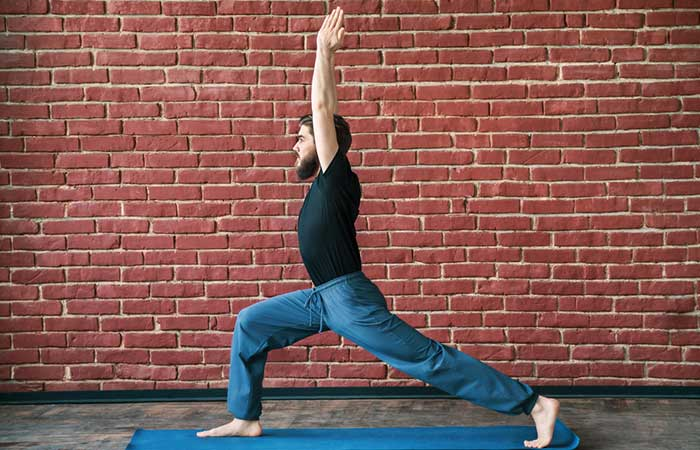2. Virabhadrasana I (Warrior Pose I)