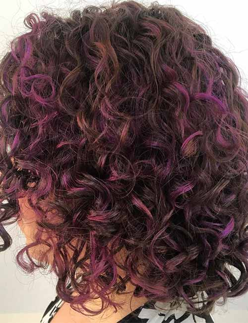 4. All Over Purple Highlights On Curly Bob