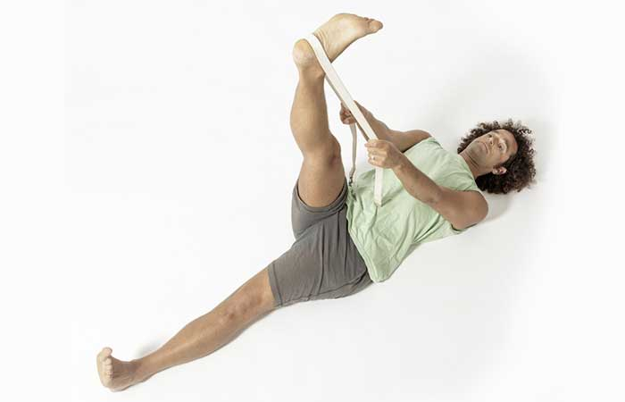 5. Supta Padangusthasana (Reclined Hand to Big Toe Pose)