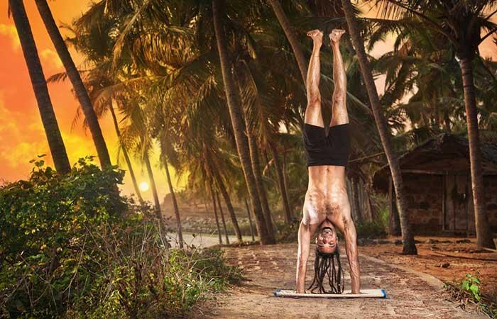 6. Adho Mukha Vrksasana (Tilted Tree Pose)