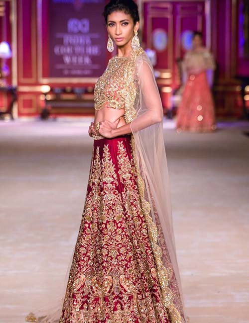 2. Heavy Gold Work Lehenga With Cape Sleeves
